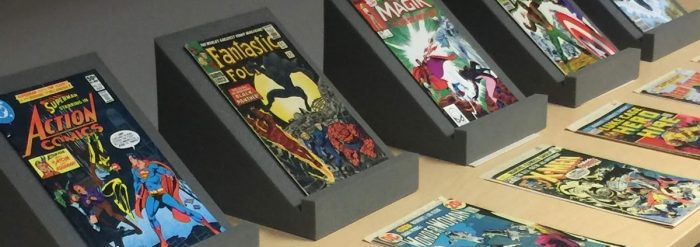 Photo: vintage comic books displayed on a table.