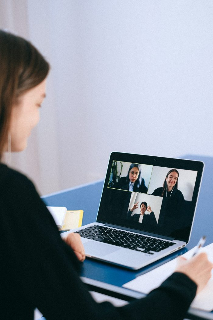 person on video chat with three others